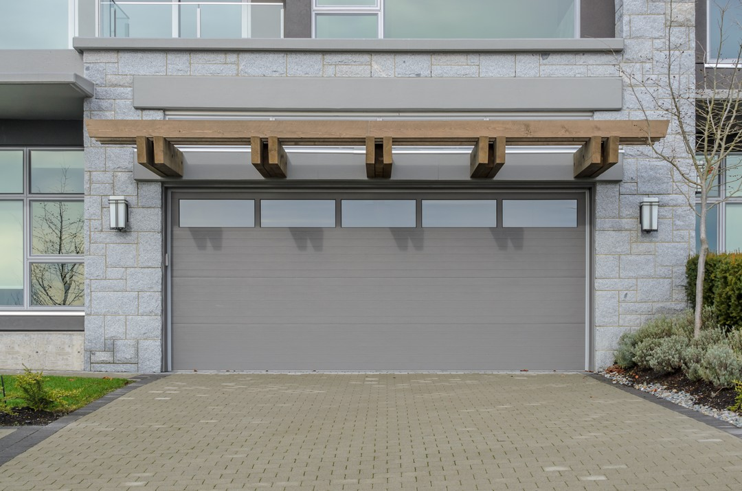 Pourquoi faire appel un professionnel pour installer sa for Porte de garage installation
